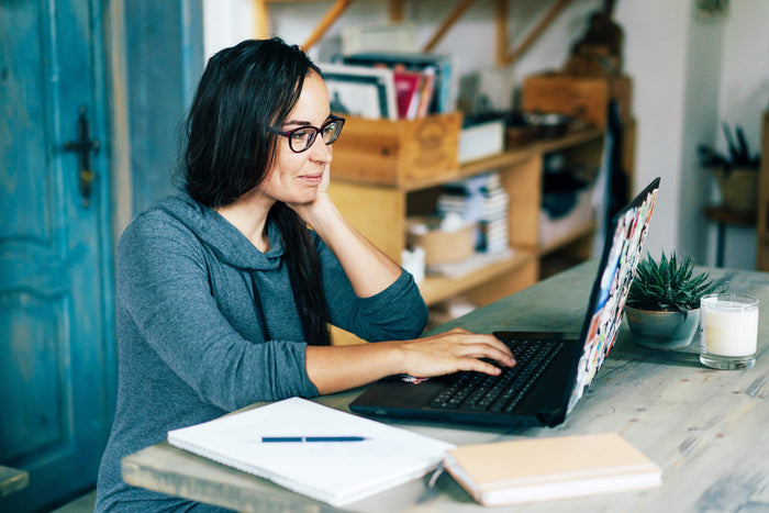 woman-working-at-home-working-from-home-tips-freelance-work-home-office-stay-healthy
