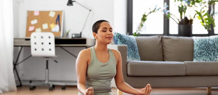 young-black-woman-meditating-yoga-at-home-self-care-wellness-tips-stay-home-staycation