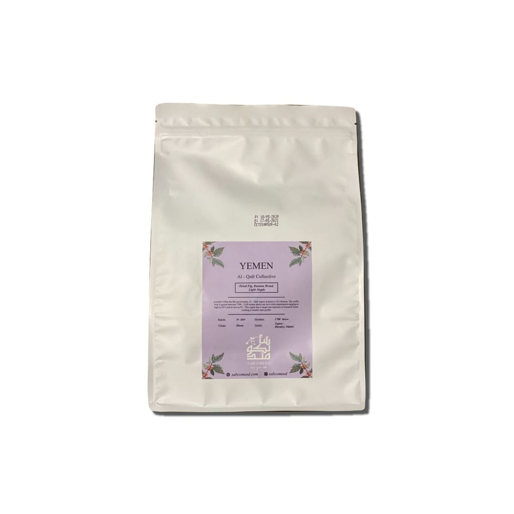 a bag of coffee beans with a purple sticker
