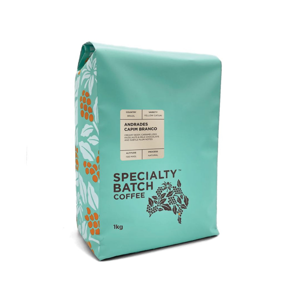 a turquoise bag of coffee beans with graphics, 1kg