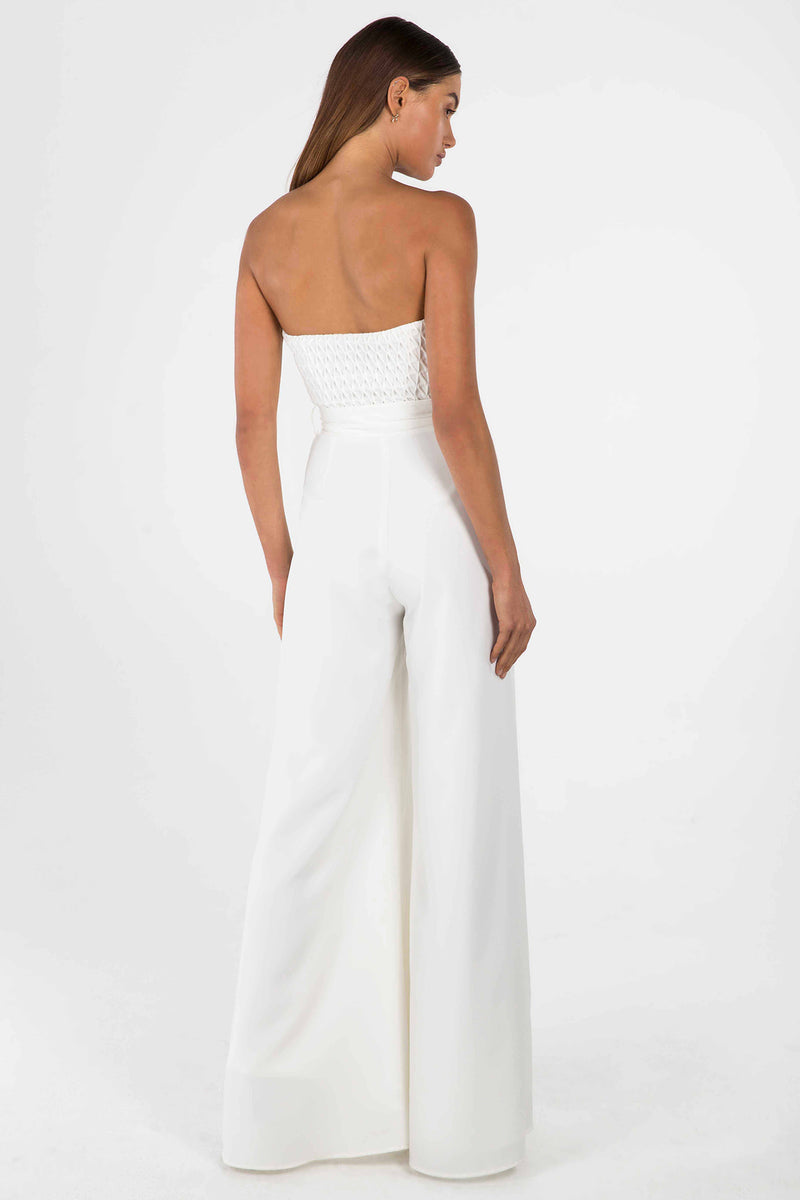 Model wears Aleyna crepe pantsuit with belt in colour ivory