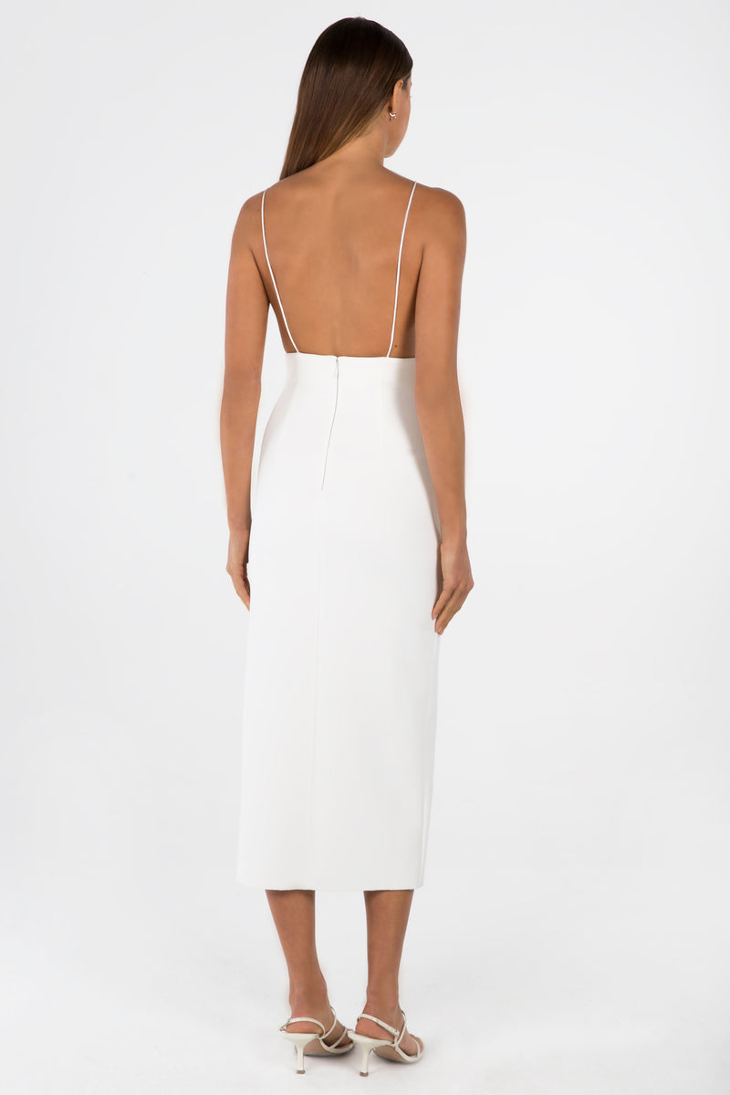 Model wears Alisa midi backless dress in colour ivory