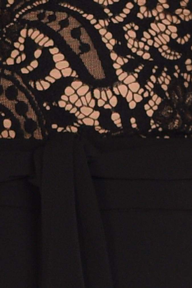 Model wears Allegra lace long sleeve pantsuit in colour black with tie waist