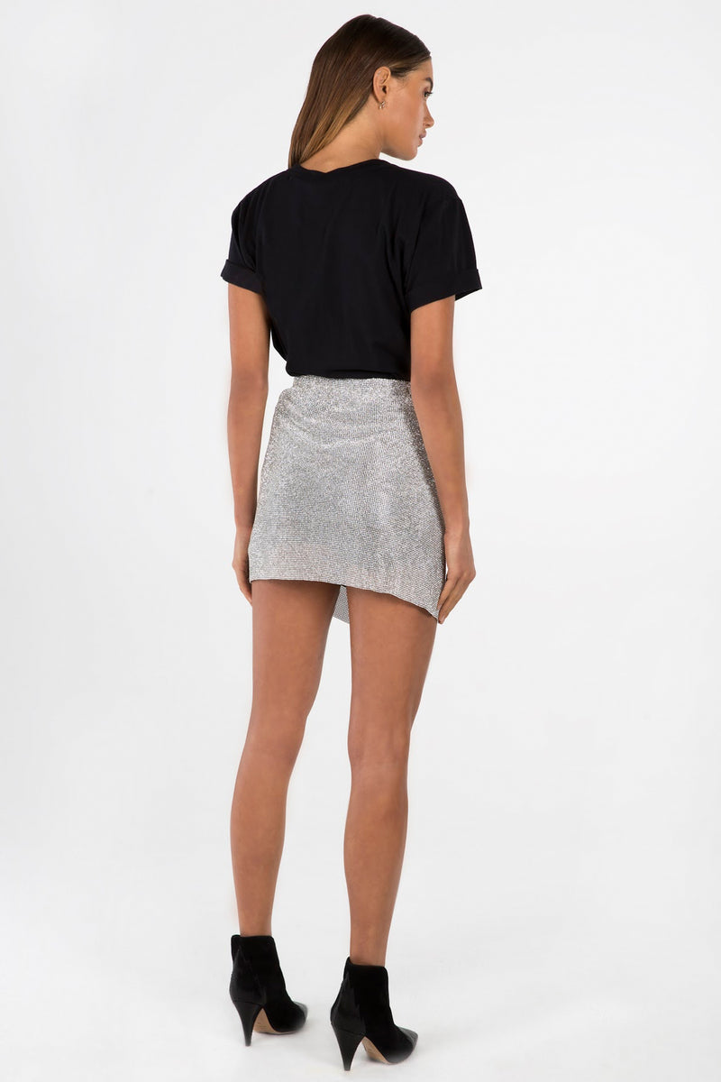 Model wears Amity mini skirt in colour silver