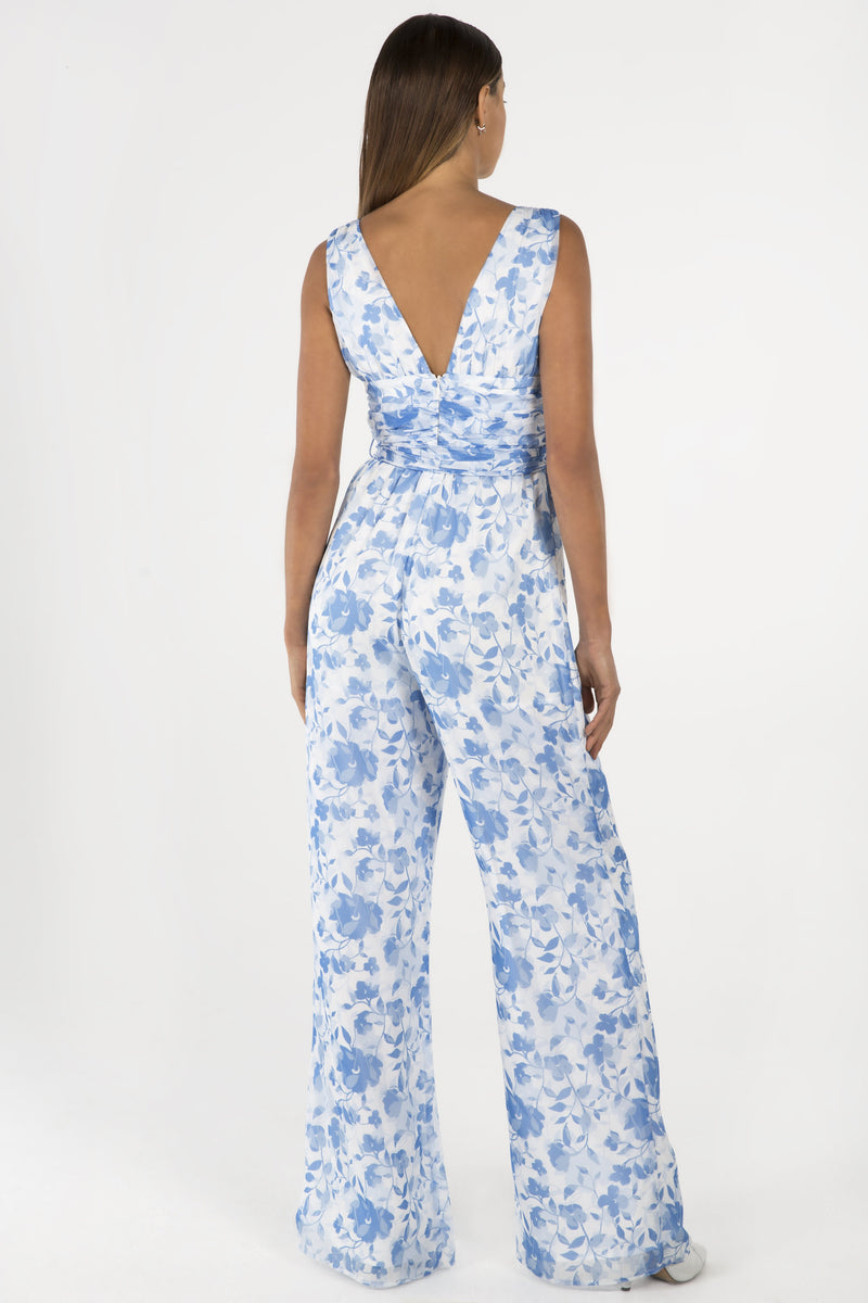 Model wears Annalisa pantsuit with v neck line and wide leg pant in colour blue floral