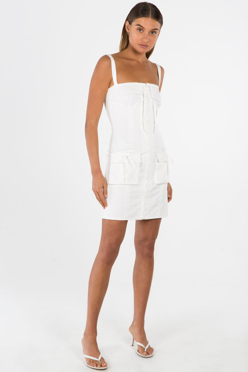 Model wears Annika mini dress in colour ivory