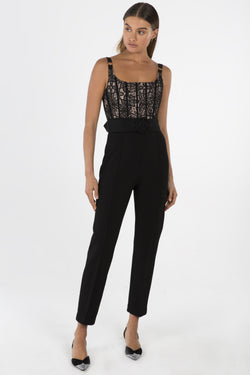 Model wears Ariella lace pantsuit in colour black