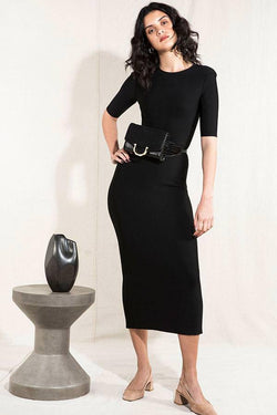 Model wears Brodie midi short sleeve dress in colour black