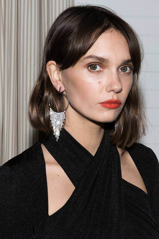 Model wears Calia tassel hoop earring in colour silver