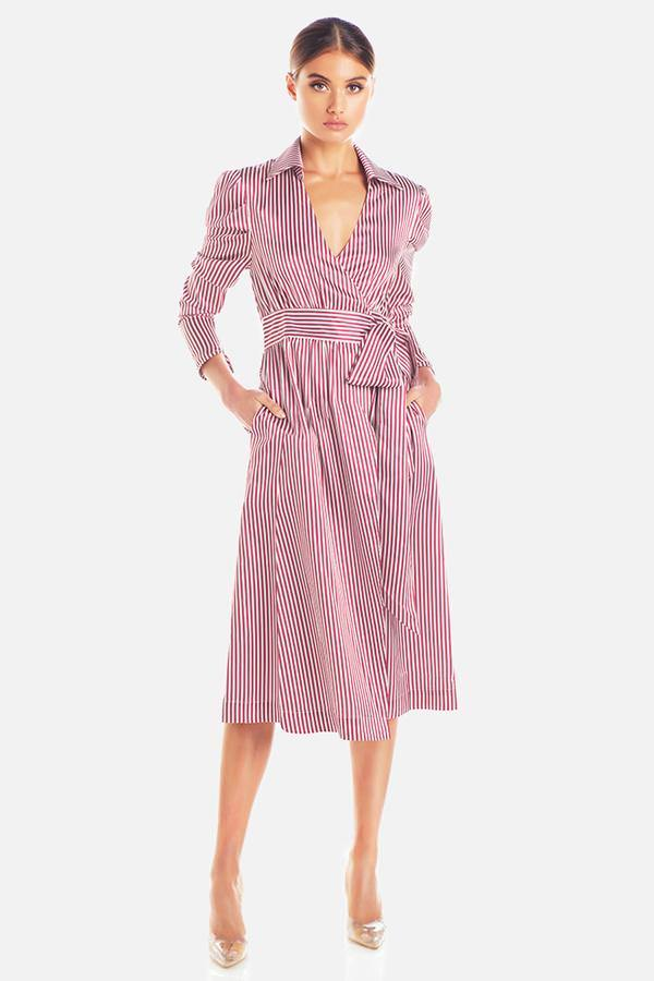 Model wears Carol stripe wrap midi dress in colour plum stripe