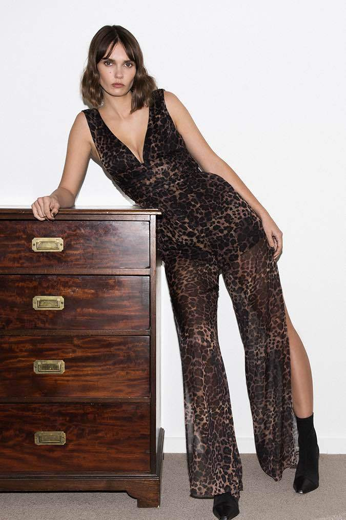 Model wears Catalina leopard pantsuit with leg slits in colour leopard