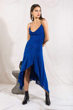 Model wearing Cherridyn midi dress with leg slit in colour cobalt