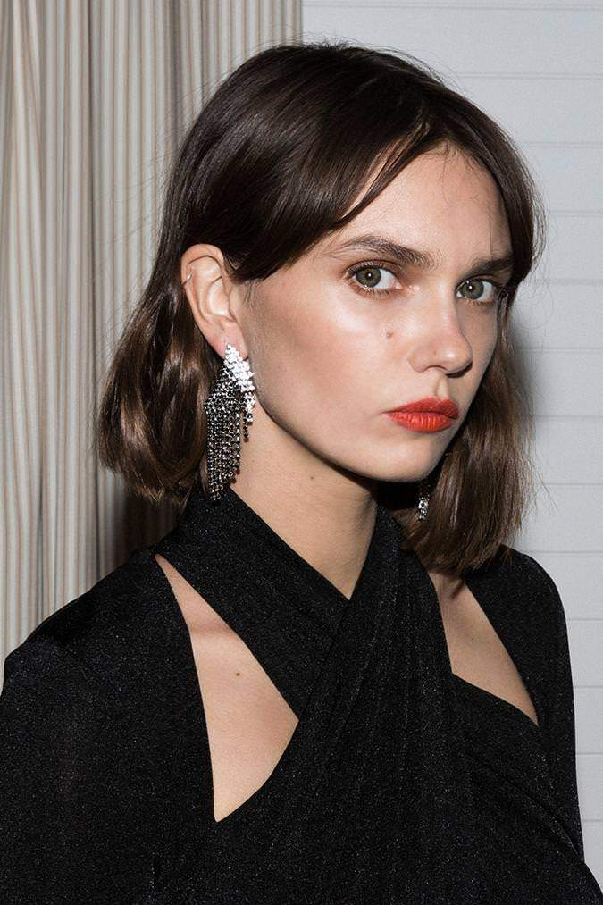 Model wears Coby multi earring in colour black and silver