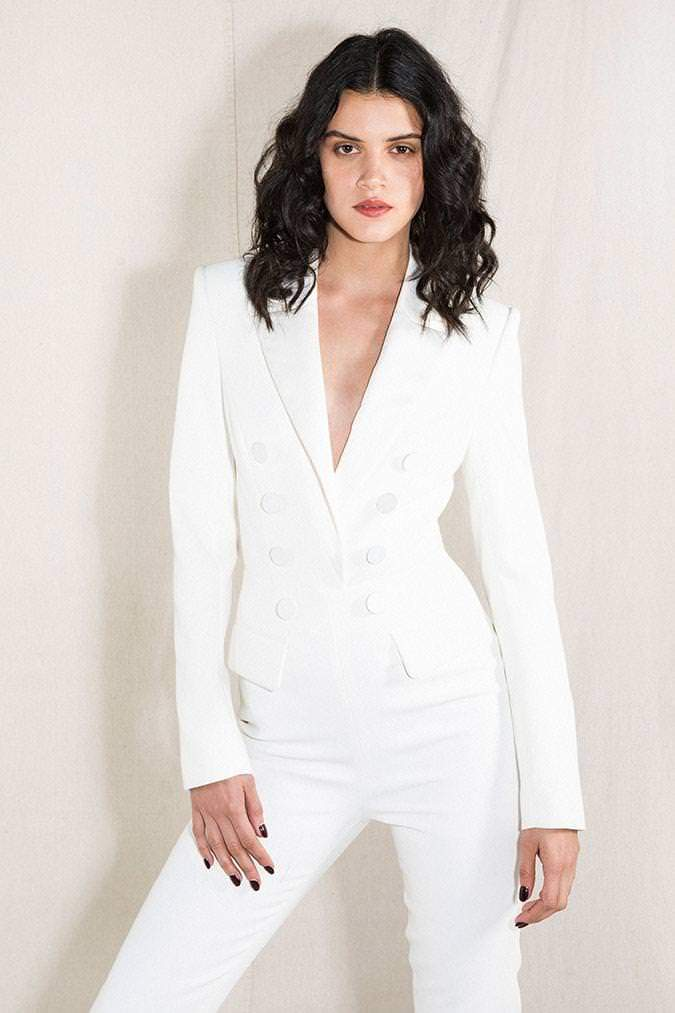Model wears Debbie pantsuit with cut out back in colour ivory