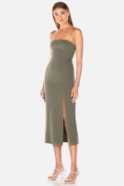Model wears Desiree midi dress with leg slit in colour khaki