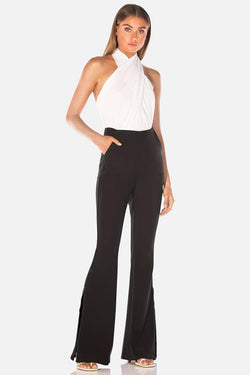 Model wears Eadie flared pant in colour black
