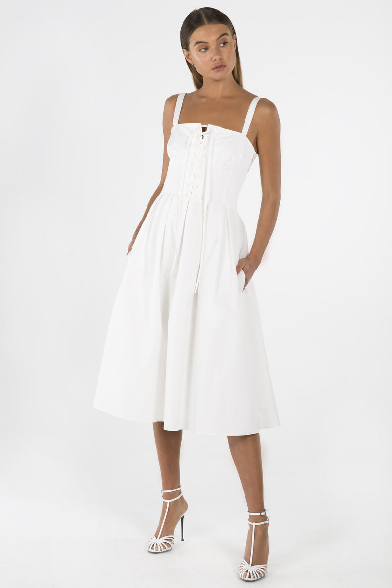 Model wears Emmaline midi dress in colour ivory