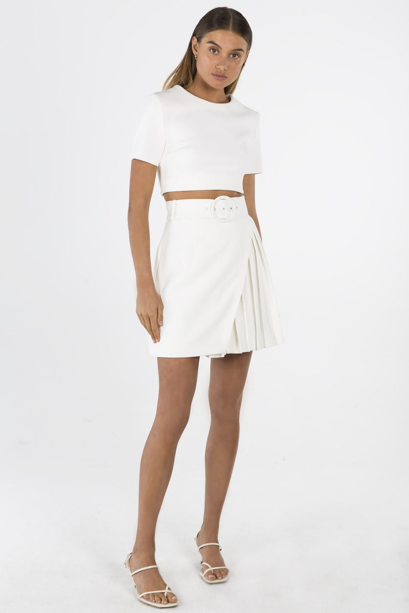 Model wears Fiorella mini skirt in colour ivory