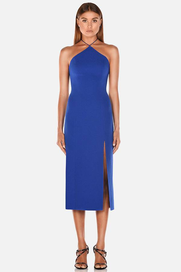 Model wears Genevieve midi halter neck leg slit dress in colour cobalt