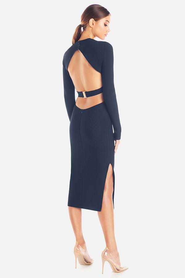 Model wearing Stacey midi backless long sleeve dress in colour navy