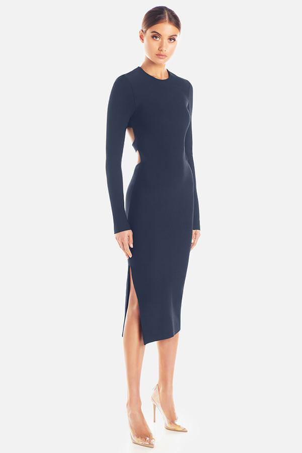 Model wearing Stacey bandage midi backless long sleeve dress in colour navy