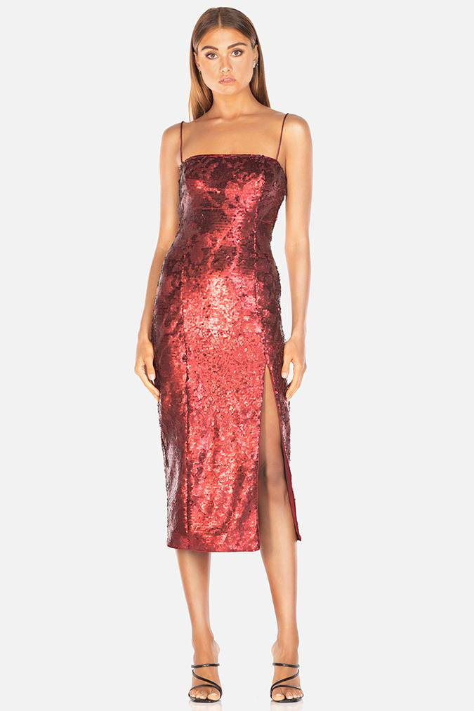 Model wearing Tamara sequin dress with leg slit in colour wine