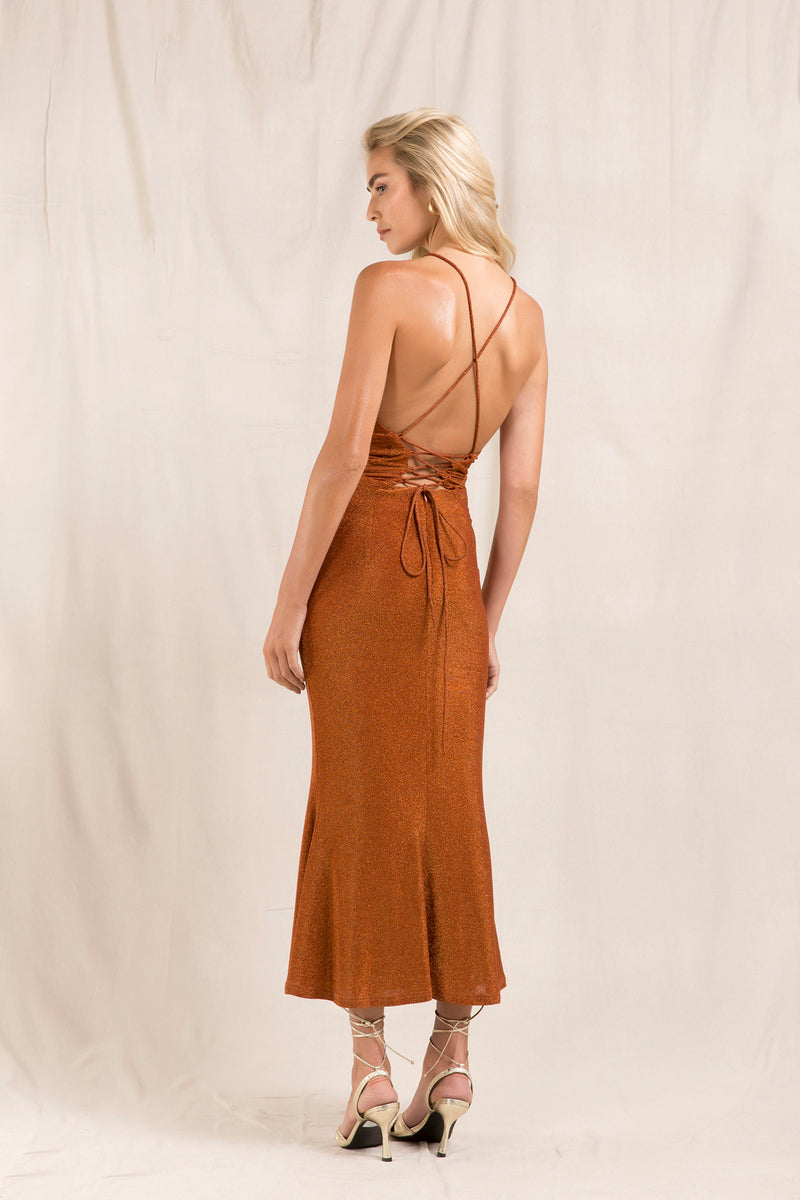 Model wears Greta backless midi dress in colour copper