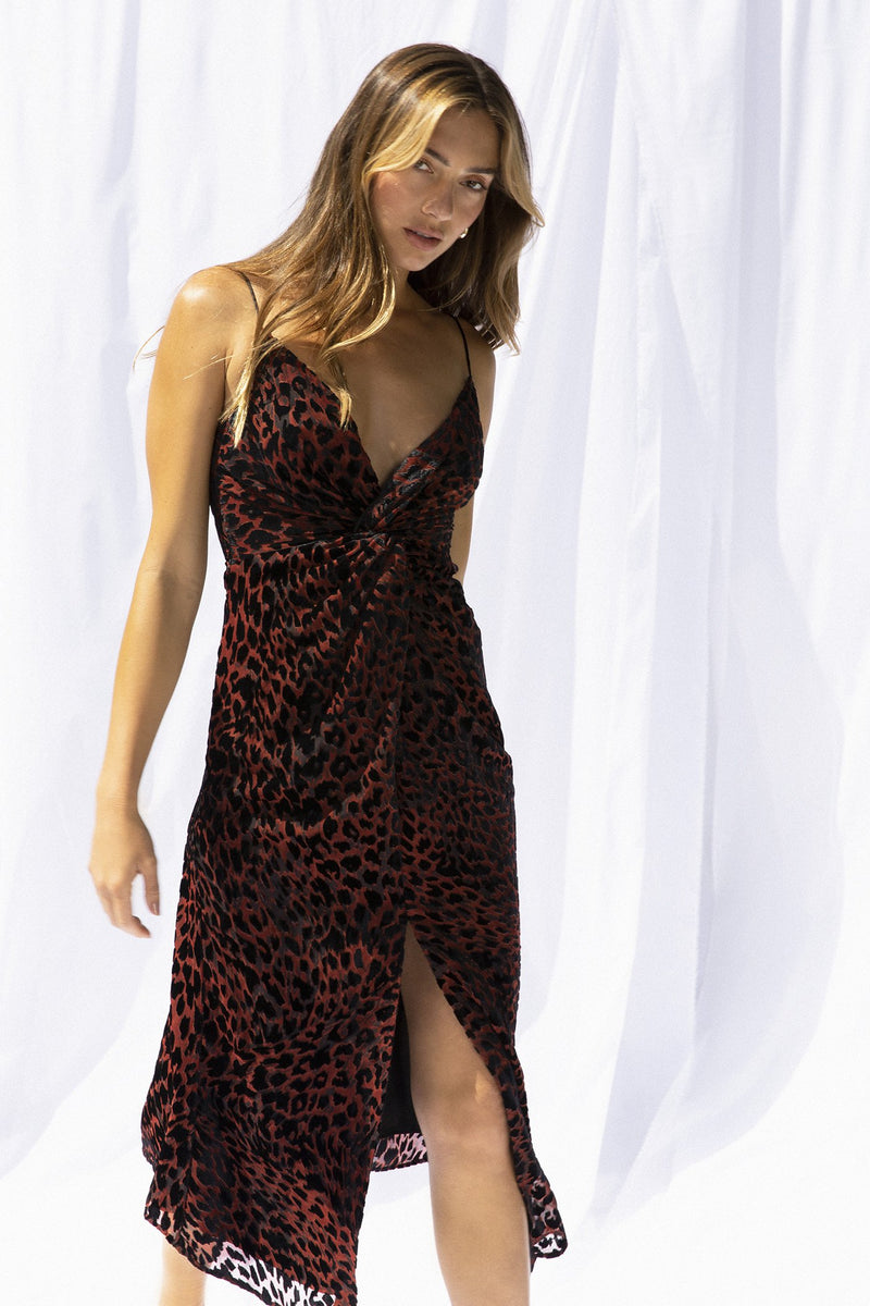 Model wears Harpa midi dress in the colour red leopard