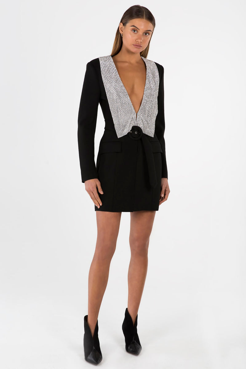 Model wears Helen blazer dress in colour black with crystal glo mesh