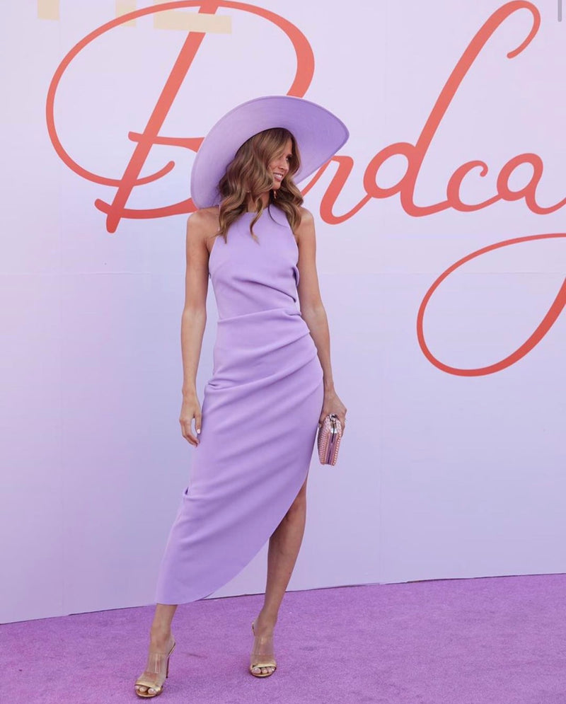 Model wears Ida midi dress with pleats in colour lilac