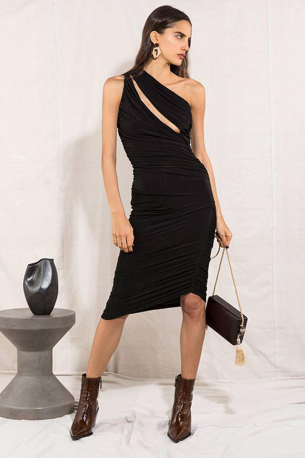 Model wears Jasey one shoulder ruched asymmetrical mini dress