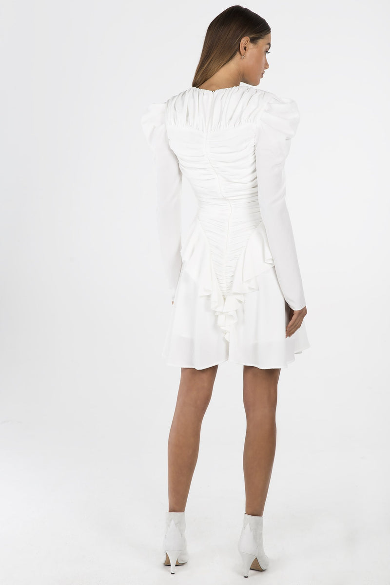 Model wears Jia long sleeve mini dress with ruching in colour ivory