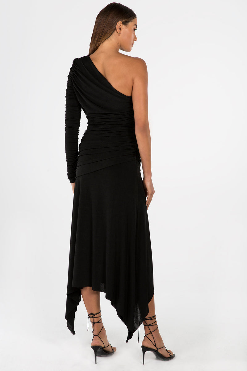 Model wears Jordanne midi one shoulder dress in colour black