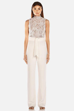 Model wears Josie lace pantsuit with tie waist in colour ivory
