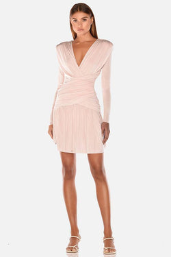 Model wears Kahlia long sleeve ruched shoulder pad backless mini dress in colour champagne