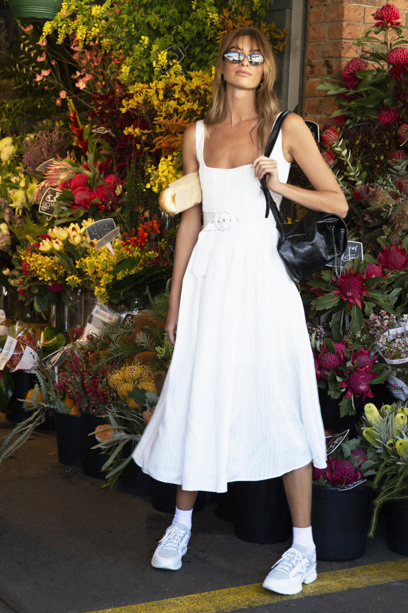 Model wears Karmella midi dress in colour ivory
