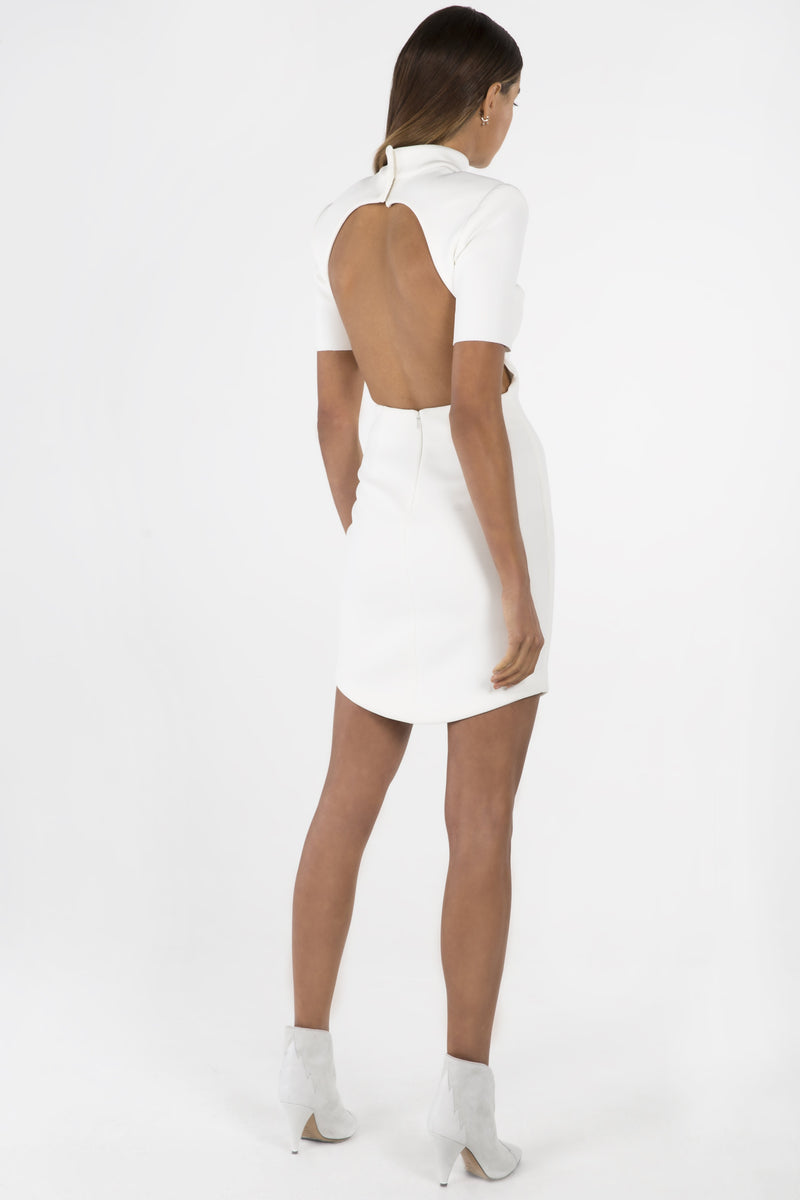Model wears Kyra mini dress in colour ivory