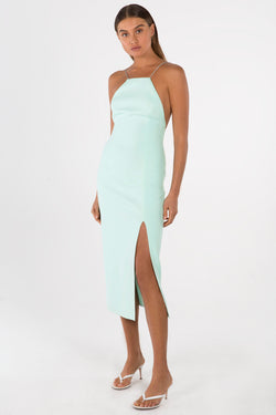Model wears Alisa midi backless dress in colour mint