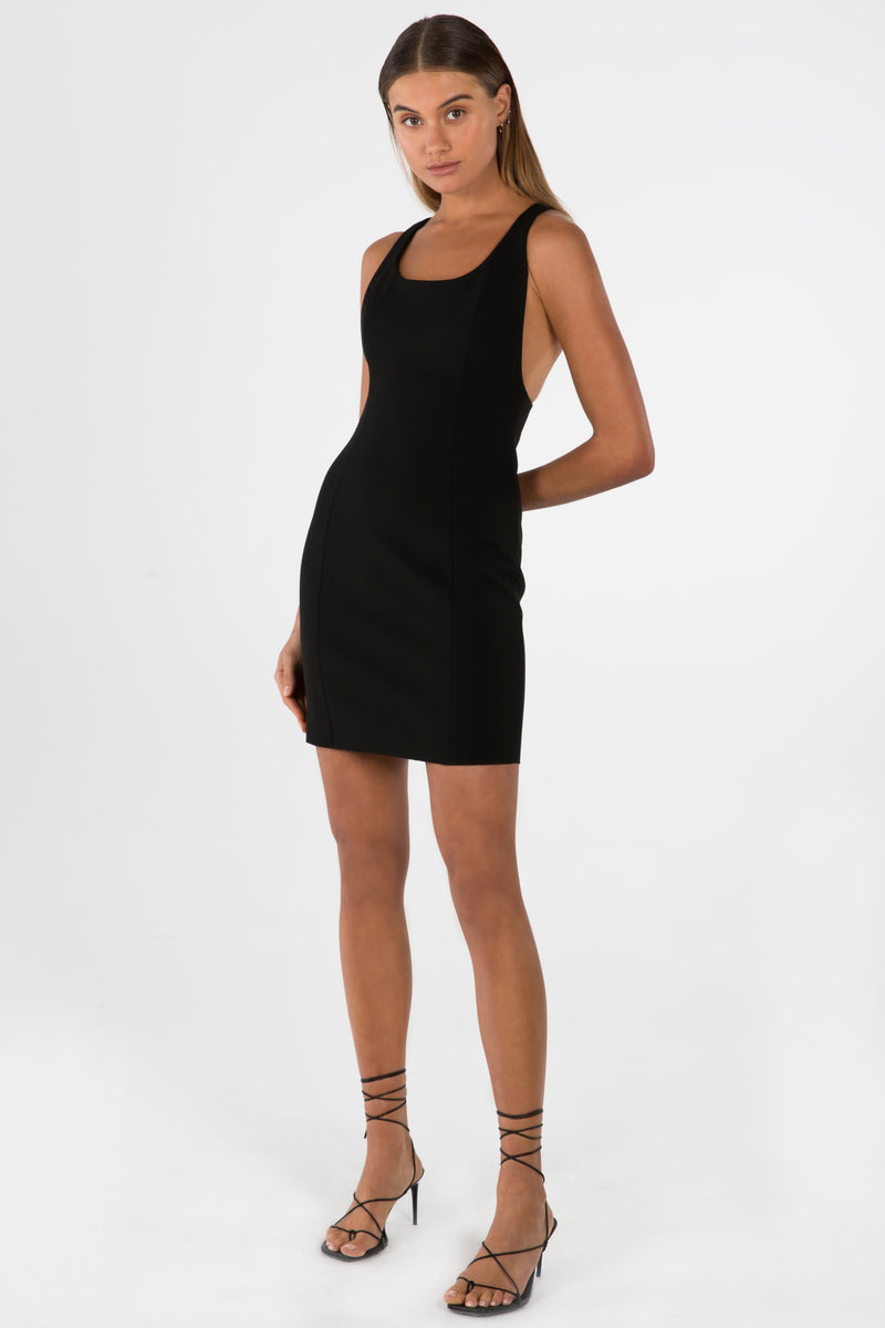 Model wears London mini dress with racerback in colour black