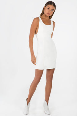 Model wears London mini dress with racerback in colour ivory