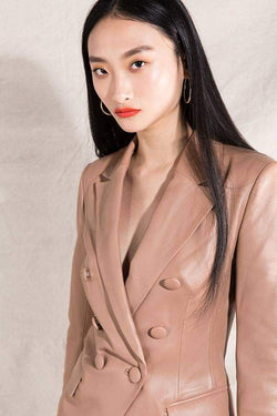 Model wears Lora leather blazer in colour nude