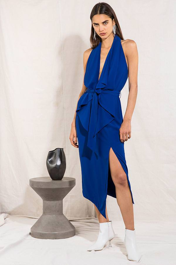 Model wears Lorena midi tie waist leg split backless dress in colour cobalt