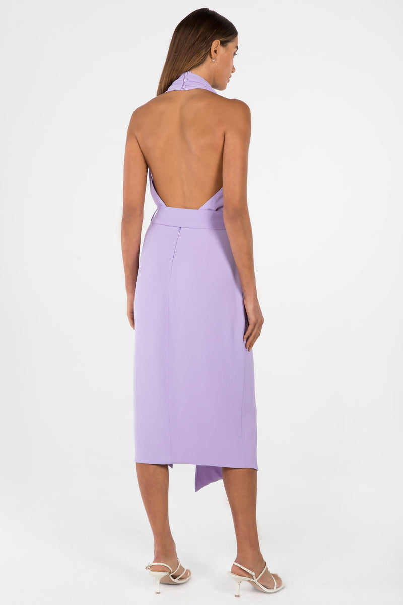 Model wears Lorena midi backless halter neck dress in colour lilac