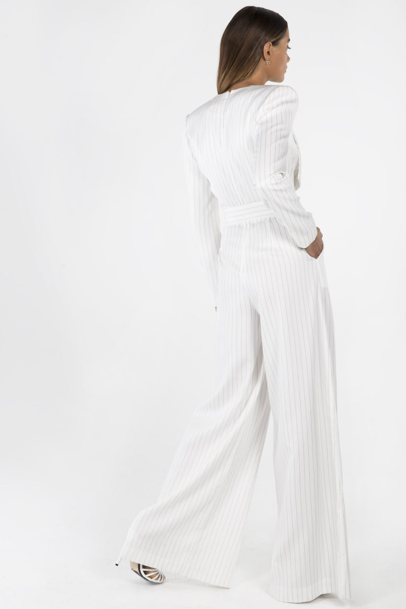 Model wears Loretta Pantsuit with wide leg pant and belt