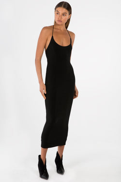 Model wears Luisa midi halter neck dress in colour black