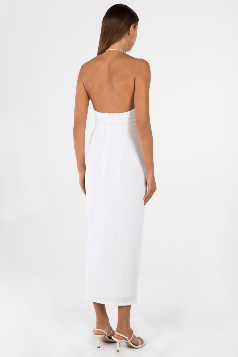 Model wears Luisa midi halter neck dress in colour ivory
