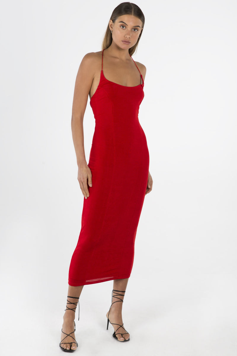 Model wears Luisa midi halter neck dress in colour red