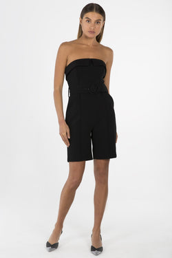Model wears Lyzie strapless playsuit in colour black