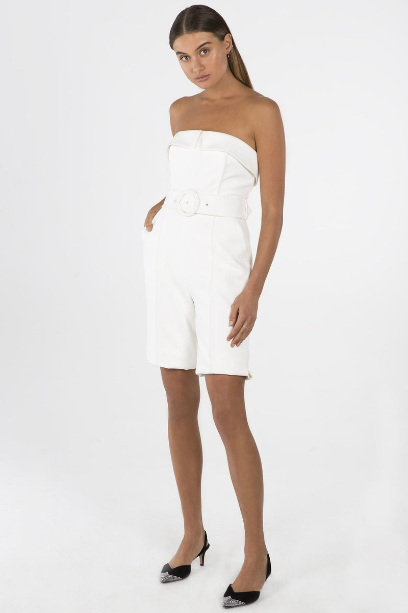 Model wears Lyzie strapless playsuit in colour ivory