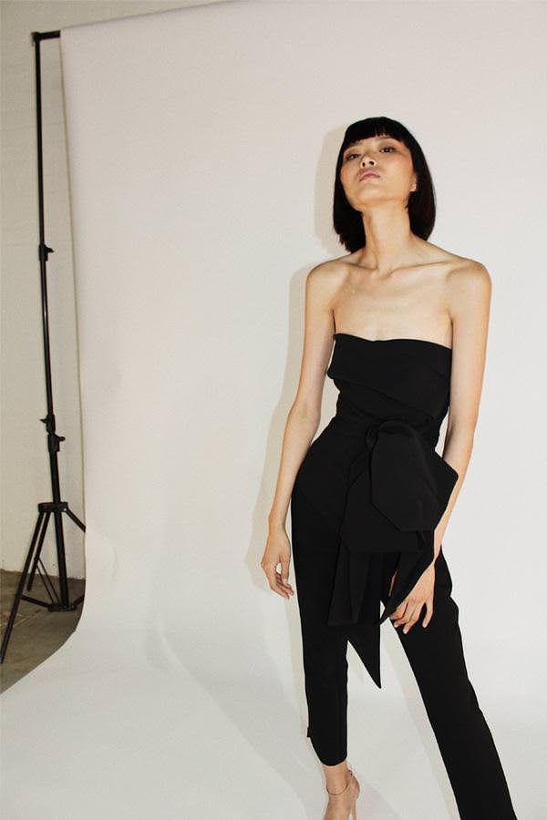Model wears Magdelena strapless tie waist pantsuit in colour black
